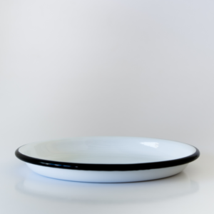 whie tapas sauce dish with blue rim